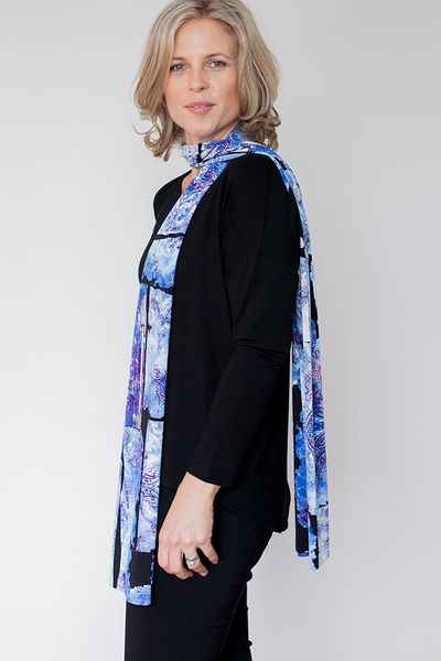 MABELLE SKY SCARF by FLAT OUT TALI The Fashion for Flatter Beauties. The Mabelle Sky is a richly patterned, blue based scarf that is a dream to feel and wear. Its drape creates elegance, and its long-line cylindrical shape provides magic that creates a perfect distraction away from a flat chest. Order yours today https://flatouttali.com/collections/enaam-battani-jewellery/products/mabelle-8602