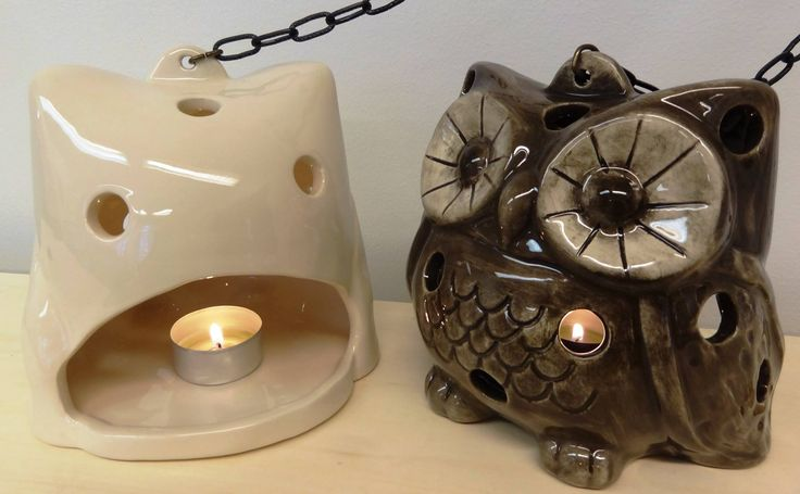Ceramic owls as candle holders.