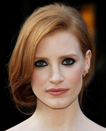 Jessica Chastain's Elegant Rolled-Under Updo. Nice choice for the date.