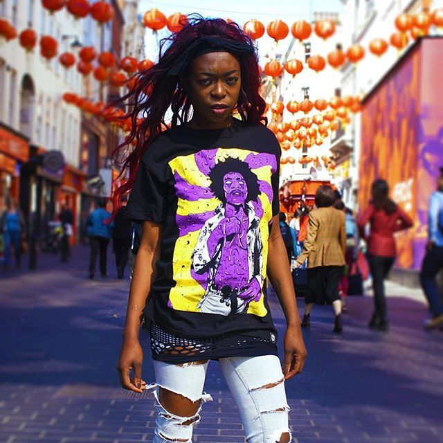 "CRMC X Deladeso ""Purple Grime"" Tee Available at www.crmcclothing.co | WE SHIP WORLDWIDE Model - Davina Miller Photography - Vizualography #hendrix #jimihendrix #grime #grimeart #dope #lit #boss #blackwear #black #loveblack #iloveblack #alternative #blackmodel #blackgirlsrock #alternativeblackwomen #beautifulblackwomen #melaningoddess #Grime #grimedesign #grimeartist #Grimeart #alternativewear #alternativestreetwear #alt #altwear #deladeso #digitaldeathandgrime #streetwear #crmcclothing"
