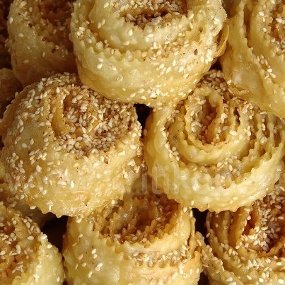 Avgokalamara... very thin dough, barely fried to crispness, drizzled with honey and walnuts, sesame... heavenly