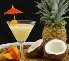 Coconut Mango-tini (2 oz. Absolute Mango vodka 1 oz. Malibu Coconut rum 1 oz. cream of coconut 3/4 oz. pineapple juice)