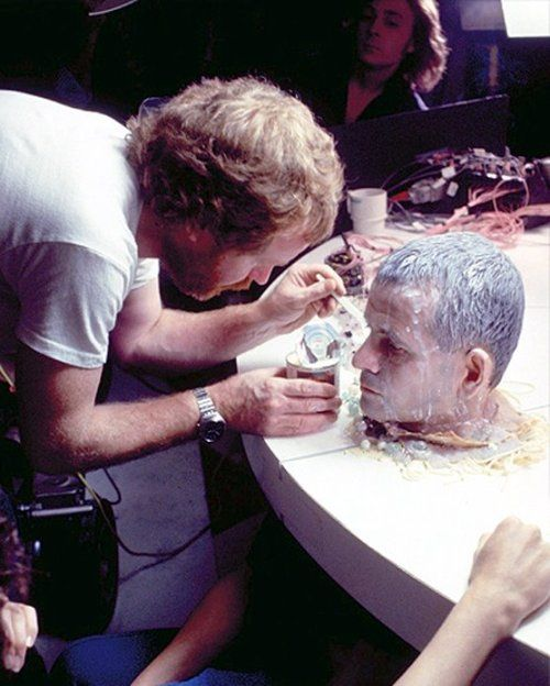 """celluloidshadows:  """" Director Ridley Scott makes sure actor Ian Holm's head looks perfect for a scene from the 1979 film """"Alien"""". Click the pic to watch the scene depicted in the photo.  """""""