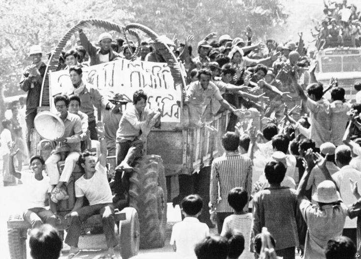 Unidentified persons wave to each other in Poipet, on the Cambodian-Thailand border, April 18, 1975, following the announcement of the fall of Phnom Penh to Khmer Rouge forces. A Khmer Rouge radio station announced that most of the top leaders of the former Phnom Penh government had been beheaded. The radio broadcast, monitored in Bangkok, also indicated fighting is still continuing in Cambodia's provinces. (AP Photo)