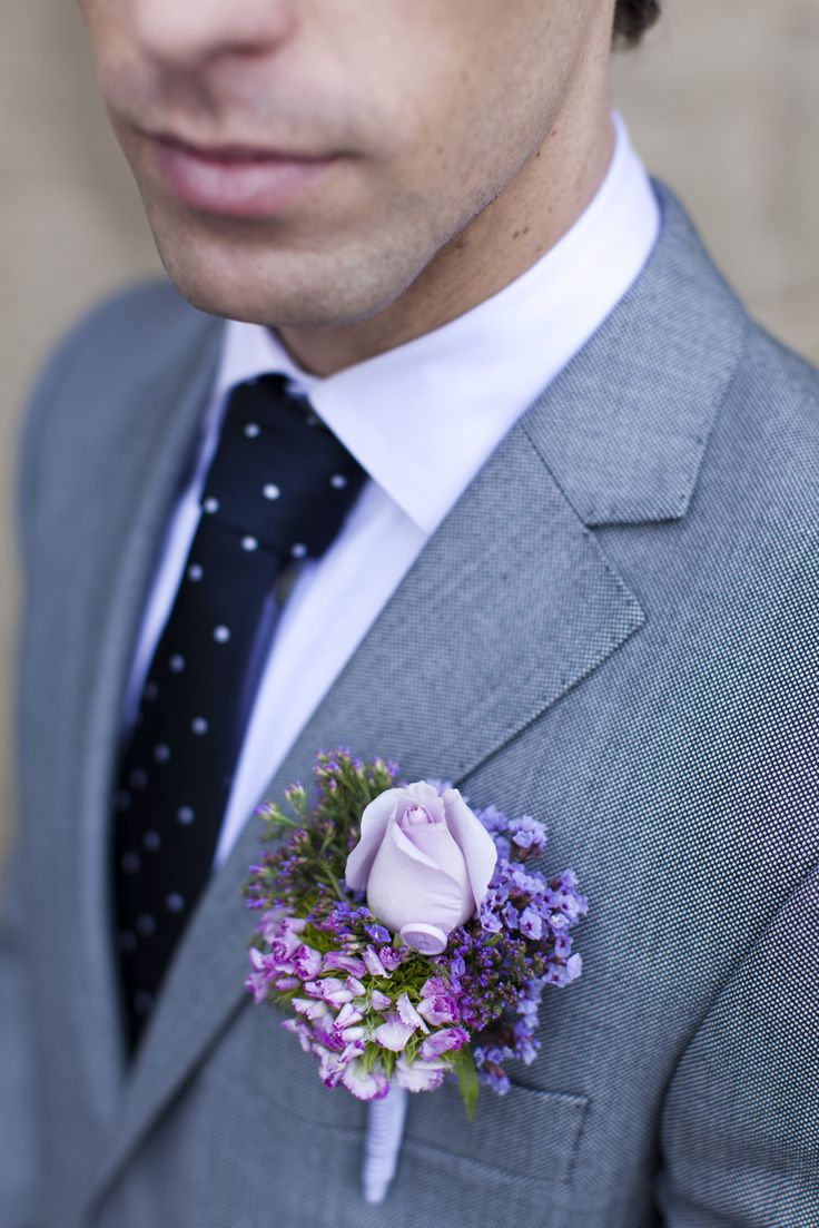 Add interest to buttonholes by surround a soft-hued rose with delicate clusters of heather and aubrietia. Tie the arrangement together with ribbon, then finish the look with a bite-sized button. New Zealand Weddings Magazine, Spring 2013 issue. Photography by Jimena Murray.