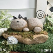stone animal.. maybe for olivia's garden!