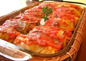 Gram's Galumpki Recipe (Polish/German Cabbage Roll) Made from lightly soft boiled cabbage leaves wrapped around minced pork or beef, chopped onions, and rice or barley baked in a casserole dish in a tomato sauce.