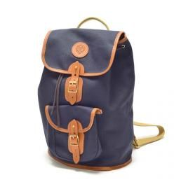 A classic canvas rucksack; ideal for browsing, commuting, cycling and everyday use in town. Features full leather piping, a zipped box pocket and bonded cotton canvas, which is rugged and waterproof. The webbing straps are 100% cotton parachute webbing, the best quality obtainable.  Hand crafted in Cumbria