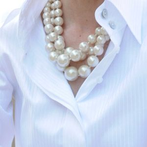 Classic white shirt and big pearls...a timeless duo.
