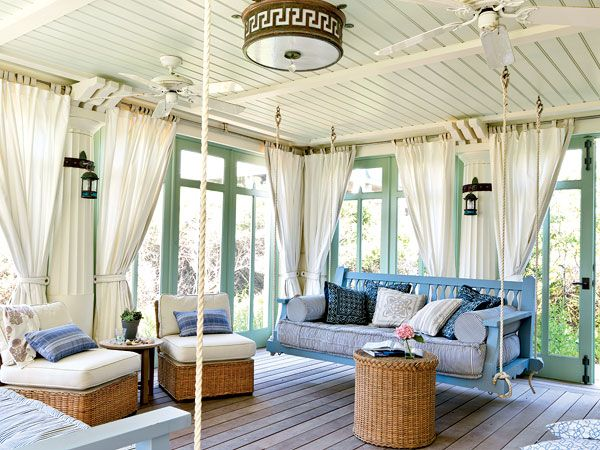 My home ideas-Seaside sleeping porch. Love this porch. Might switch out one of the swings for a suspended daybed. With lots of pillows. Obviously for reading. Ok, well maybe my beauty sleep.