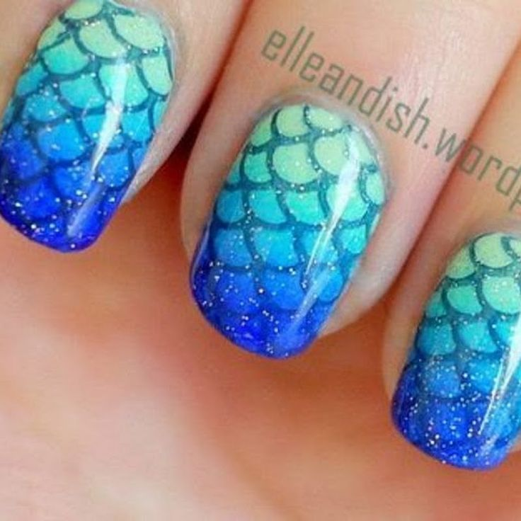This unique manicure shows mermaid scale pattern on of blue, aqua and mint ombre. Glitter nail polish adds magic to the nail art design. Watch the video tutorial and DIY.