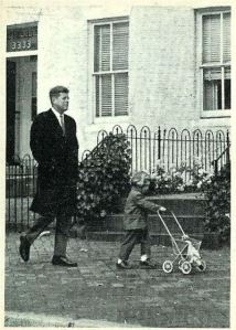 The president-elect John Kennedy walks his three year old daughter Caroline near his home in Georgetown.    #6 in a series of 77 John F. Kennedy cards