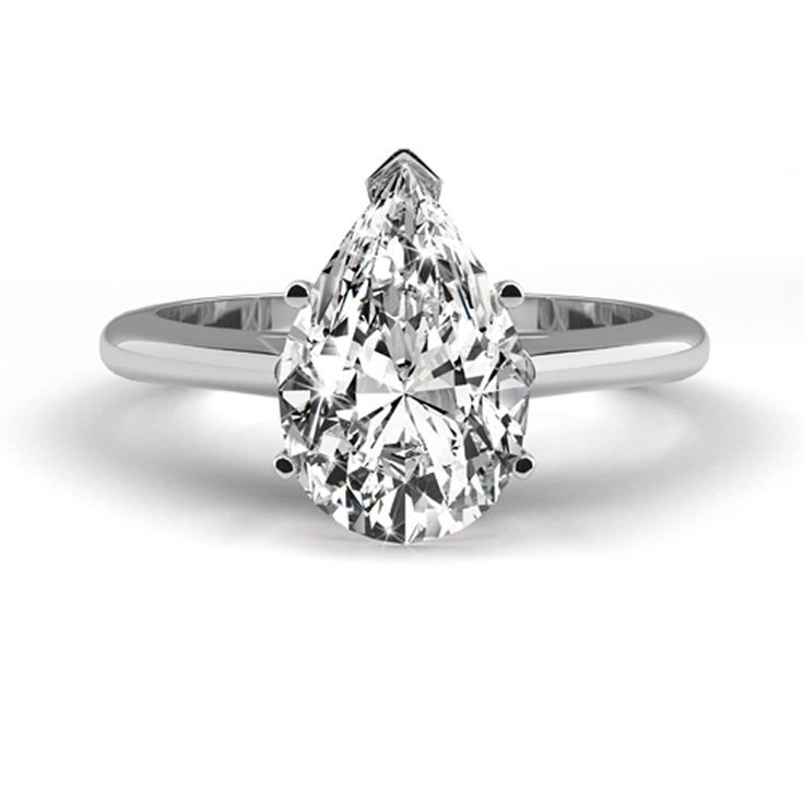 A 0.82 Carat D VS1 diamond is mounted in beautiful 14K White Gold with a 5 prong setting on a delicate shank.