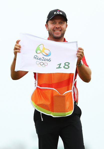 Brad Beecher caddie for gold medalist Inbee Park of Korea poses with the 18th…