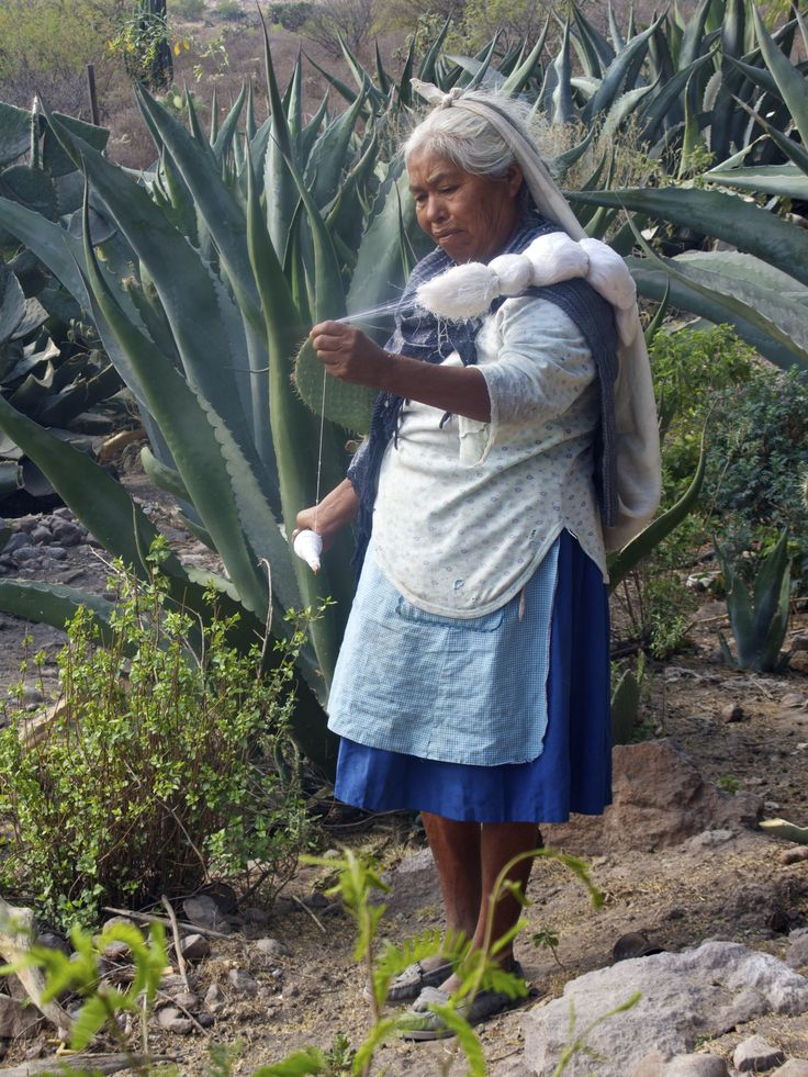Woman spinning agave