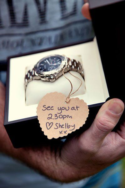 "Why We Love It: Give this cute gift to your groom on the morning of your wedding!Why You Love It:  Such a clever way to deliver the gift!"" —Melissa P. ""I got my husband a watch. The note said, 'You have no excuse to be late today... or for the rest of your life!!!!'"" —Carly D. ""That's an awesome idea, especially since my fiancé loves watches!"" —Josephine B.Photo Credit: Leoni Bolt Photography"