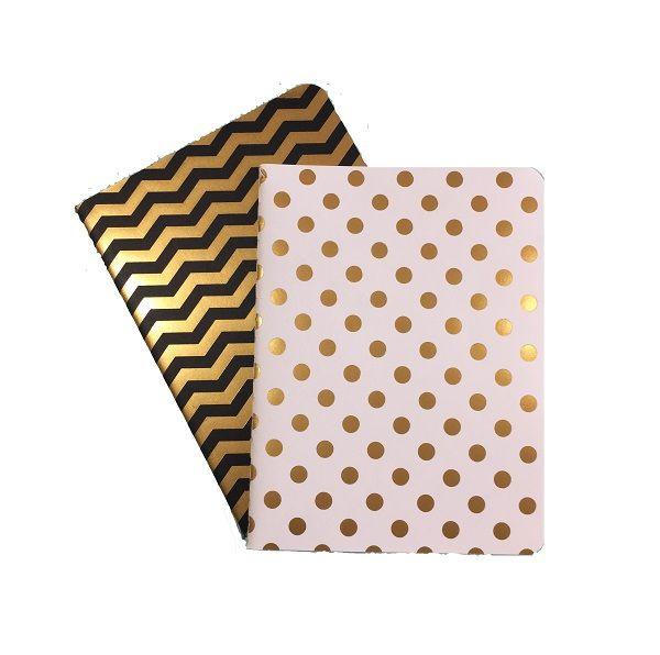 Duo libretas bolsillo blanca y negra con detalles dorados y hoja de rayas.