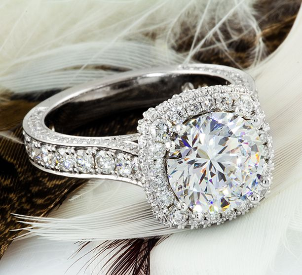 Engagement Halo ring. 3.0ct round Diamond center stone. Cushion setting! Diamonds in every corner and side.