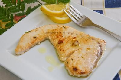 grilled swordfish filet with garlic sauce and lemon image by Ramon Grosso from Fotolia.com