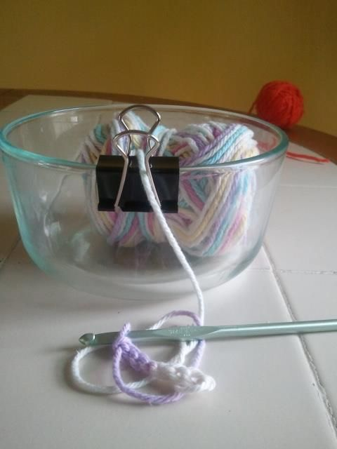 A simple binder clip can turn any bowl into a yarn bowl.