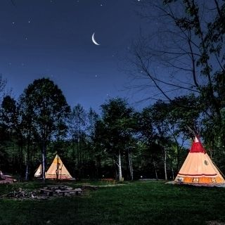 "Teepee Camping at North Georgia Canopy Tours - North Georgia Canopy Tours™ offers seven teepees offering ""glamping."" Each teepee has heat/AC, lighting, and electrical outlets. Each teepee has been painted with authentic Cherokee symbols, themes and patterns relating to the Seven Clans of the Cherokee Indians clan camping area in which they are located."