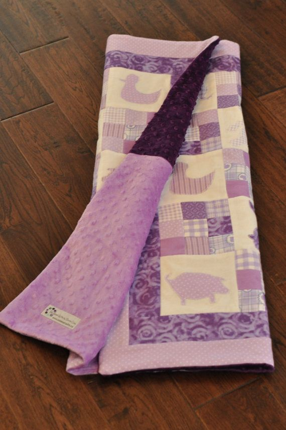 Adorable purple baby quilt. For purple baby nursery. Cute animal shapes!