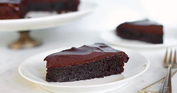 Rich, deep-dark flourless chocolate cake with chocolate-ganache glaze.