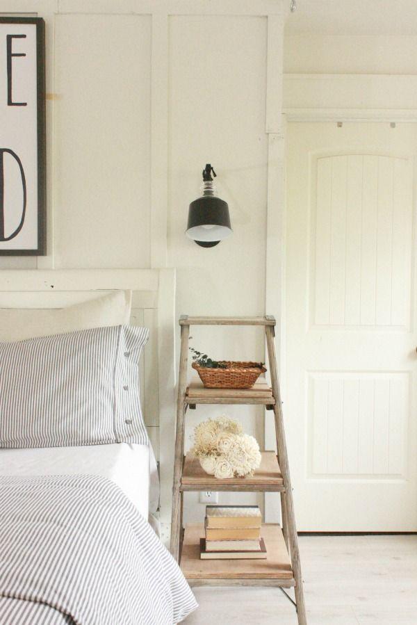Farmhouse Master Bedroom | ladder night stand | neutral decor | farmhouse decor | swing arm lamps | ticking stripe