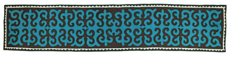 Shyrdak runner rug from Felt in bright blue, black and white, with a green trim 0.8m x 3.8m feltrugs.co.uk