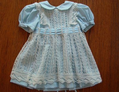 Katy's 1st birthday dress. Sewed the dress and knitted the pinafore