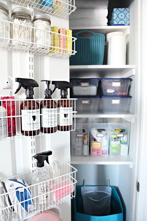 A back of the door rack is a great way to gain extra storage for cleaning supplies and most-used items. Storage baskets and boxes inside the linen closet make it function and organised