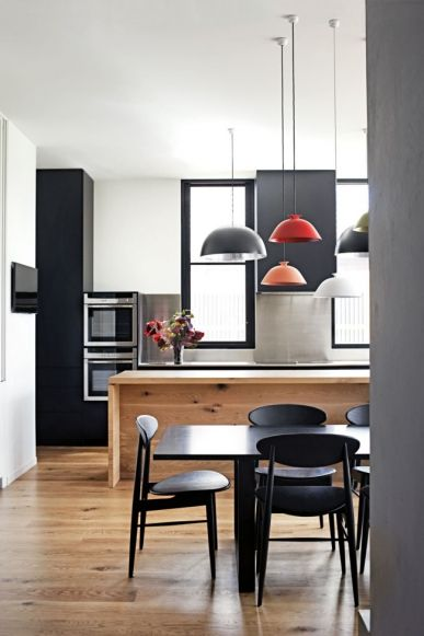 """Get the look: minimalist kitchen: For this heritage-listed house in the beach-side suburb of Brighton, architect Emma Templeton needed to construct a new service space that could handle the exuberance of four young children plus pets. She designed a three-metre island bench in solid oak that seems almost to have folded up from the solid oak floor, and detailed a large pantry behind clutter-concealing pocket doors. """"The pendant lights add a sculptural quality to the room and  introduce a…"""