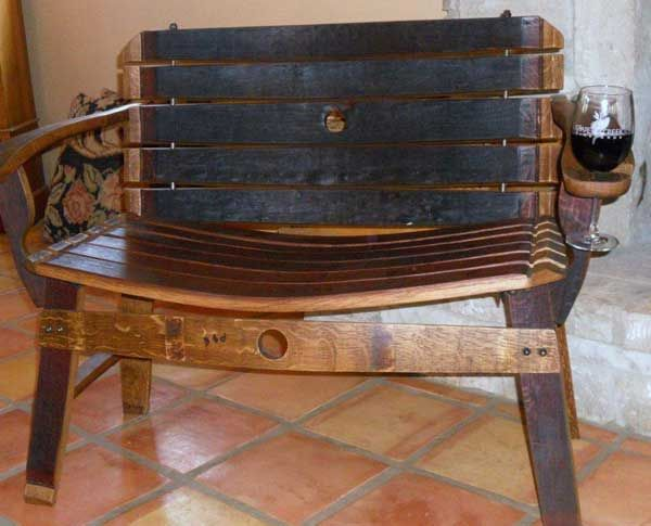 An actual wine barrell chair with built in wine holder.