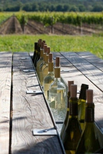 When having a dinner party, pay attention to innovative little touches like keeping the wine chilled and out of the way!