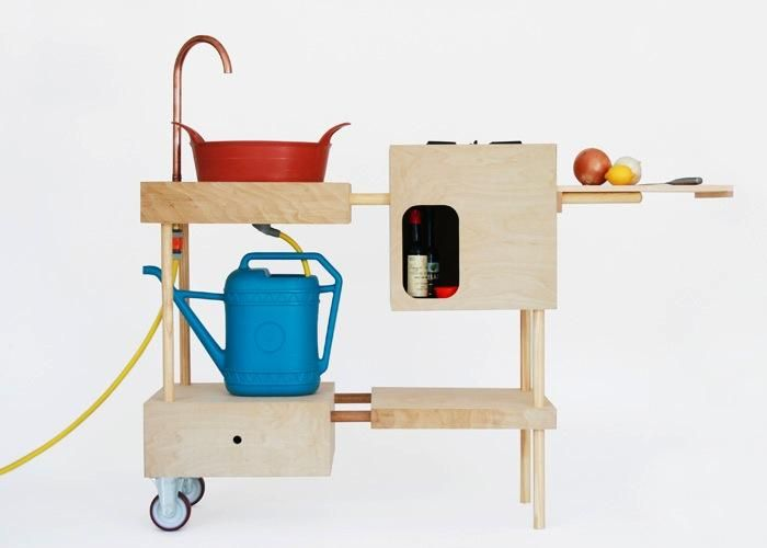 """Nina Tolstrup from Studiomama loves to cook outside. """"With this Outdoor Kitchen, I can do my chopping, peeling as well as my cooking,"""" she says. A bucket forms a sink connected to the garden hose, while waste water is collected in a watering can below."""