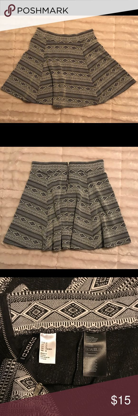 EUC H&M Divided skirt Black and white Aztec design skirt. Super cute! Only worn twice. Divided Skirts Circle & Skater