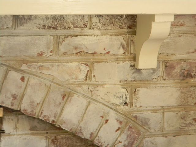 whitewashed brick fireplace | Nine Red: Painting the Brick Fireplace