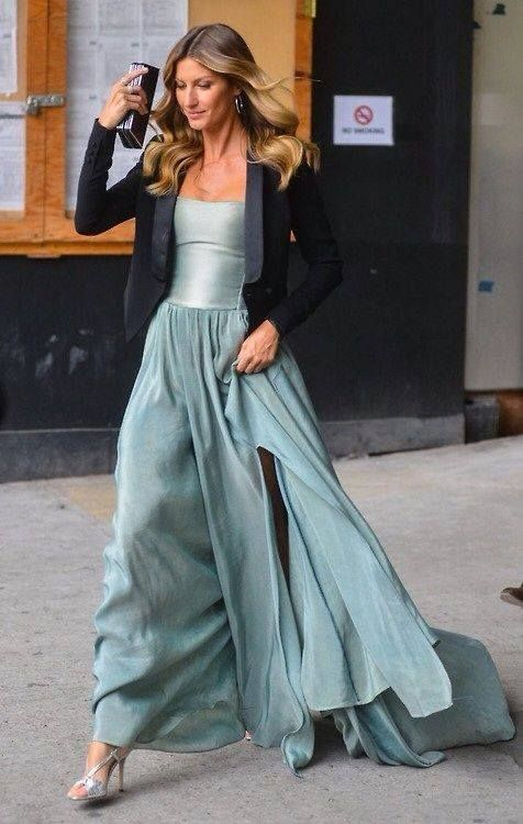 Gisele Bündchen in a romantic ball gown matched with a smoking jacket.