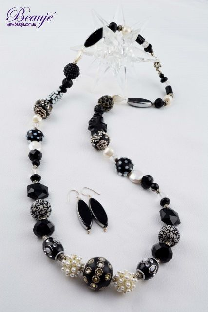 Classic black and white combo-feature glass and silver beads with pearls and onyx