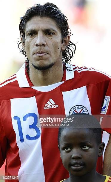 Paraguay's midfielder Enrique Vera listens to his national anthem prior to the start of the Group F first round 2010 World Cup football match...