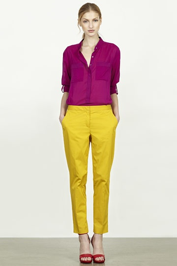 DKNY: #Magenta #blouse, yellow trousers and red shoes.