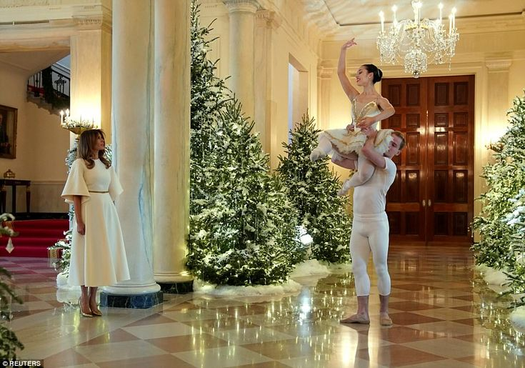 First lady Melania Trump hosted children to the White House Monday as she walked through a fully-decorated executive mansion, unveiling her vision of a Trump Christmas.