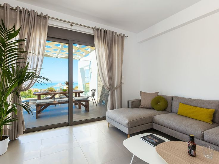 Rethymno villa rental - Open plan living room area with direct access to the garden!