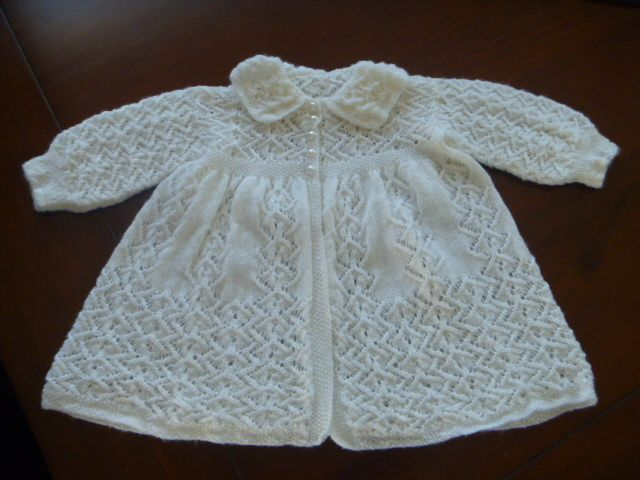 2 ply Carrying Coat knitted with merino pure wool.  Has pearl buttons and the skirt is knitted in one piece.  It is a gorgeous coat and can be unisex but on record, I have only knitted if for girls.