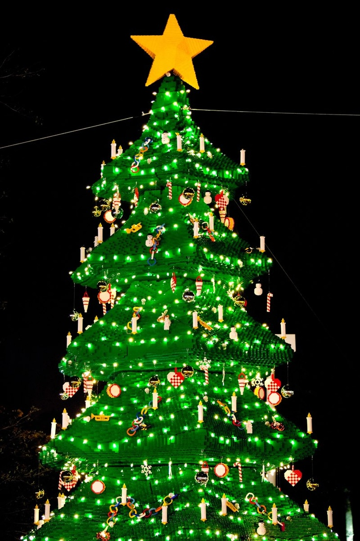 """30-foot-tall LEGO Christmas tree made with a combination of 270,000 forest green LEGO and DUPLO® bricks. The season's first official tree lighting during the LEGOLAND Florida Christmas """"Bricktacular"""" ceremony will be held Nov. 29 at 5 p.m."""