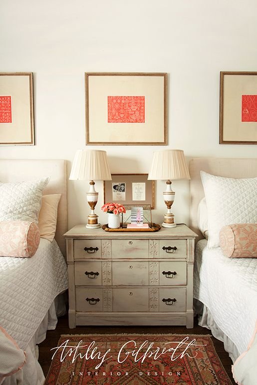 One nightstand with two lamps between twin beds ~ pictures hung all the way across...love the balance!