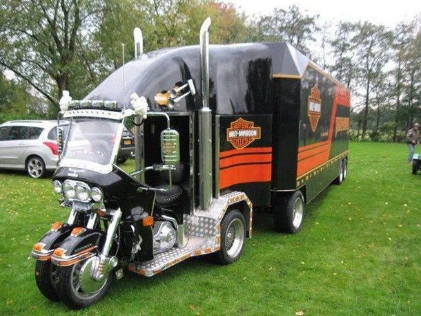 Harley-Davidson Mullet of Transportation: party in the front & business in the back. A motorcycle in the front with a semi-truck in the back.