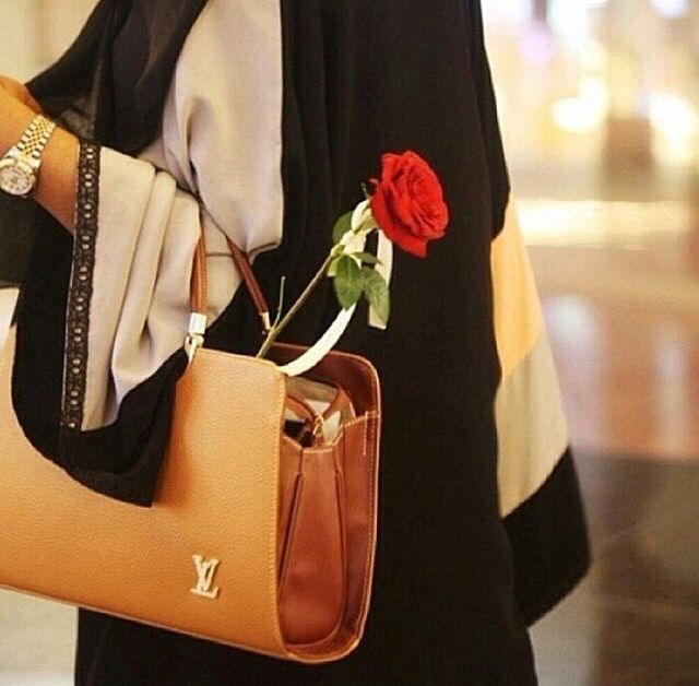 Arab girl with red rose and handbag!