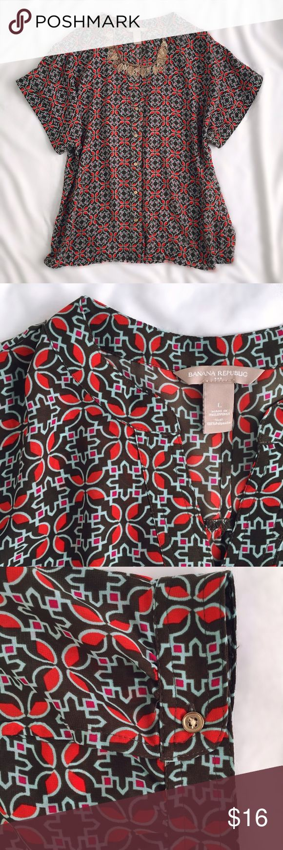 """Banana Republic Dolman Sleeve Shell Banana Republic button-down shell with dolman sleeves. Cute button detail on back of each sleeve (shown in 3rd picture.) Olive green color with blue and fuchsia accents. Lightweight and may need a cami underneath. Approximate flat measurements: 20"""" bust • 26"""" long. EUC! Banana Republic Tops"""