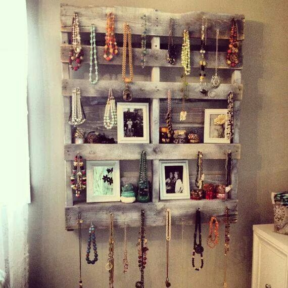 Take a wood pallet and paint (or stain) it, screw in decorative hooks or nails, and hang jewelry or hats/scarves on it